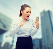 Screaming businesswoman with smartphone — Stock Photo