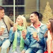 Group of smiling friends with take away coffee — Stock Photo #62451623