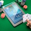 Casino poker player with cards, tablet and chips — Stock Photo #62454673