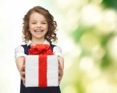 Happy smiling girl with gift box — Stock Photo