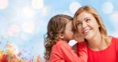 Happy daughter whispering gossip to her mother — Stockfoto