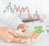 Close up of woman hands with chart and money — Stock Photo