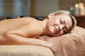 Close up of woman having hot stone massage in spa — Stockfoto