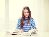 Happy smiling student girl with books — Stock Photo