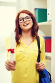 Smiling female student with laptop bag and diploma — Stock Photo