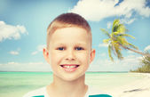 Smiling little boy over green background — Stock Photo
