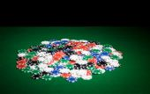Close up of casino chips on green table surface — Stok fotoğraf