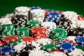 Close up of casino chips on green table surface — Stock Photo