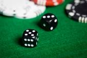 Close up of black dices on green casino table — Stock Photo