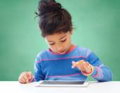 Little girl with tablet pc — Stock Photo