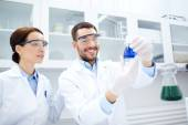 Young scientists making test or research in lab — Stock Photo