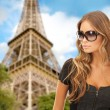 Beautiful young woman in shades — Stock Photo #62806213