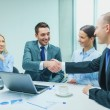 Two businessman shaking hands in office — Stock Photo #62809101