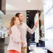 Couple looking to shopping window at jewelry store — Stock Photo #62813183