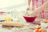 Close up of female hands kneading dough at home — Stock Photo