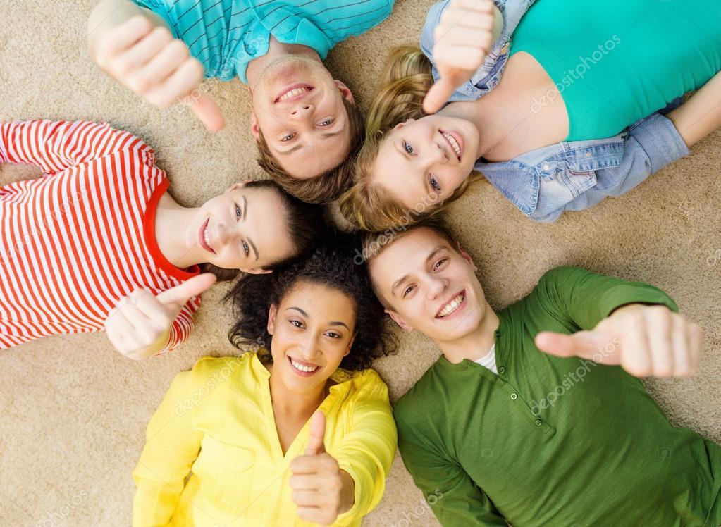depositphotos_62857619-group-of-smiling-people-lying-down-on-floor.jpg