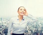 Smiling businesswoman listening gossig — Stock Photo