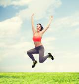 Sporty teenage girl jumping in sportswear — Stok fotoğraf