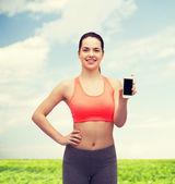 Mulher desportiva com smartphone — Foto Stock