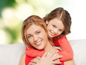 Happy mother with daughter hugging and talking — Stock Photo