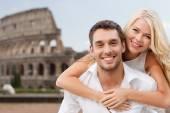 Happy couple hugging over coliseum — Stock Photo