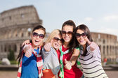 Happy teenage girls or women showing thumbs up — Stock Photo