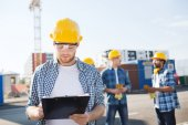 Group of builders in hardhats outdoors — Stock Photo