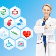 Smiling doctor over medical icons blue background — Stock Photo #63039569