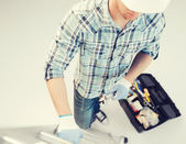 Man with ladder, toolkit and spanner — Stock Photo