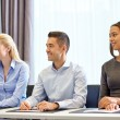 Group of smiling businesspeople meeting in office — Stock Photo #63097075