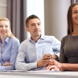 Group of smiling businesspeople meeting in office — Stock Photo #63097083