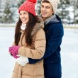 Happy couple ice skating on rink outdoors — Stock Photo #63097721