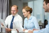 Business people with papers meeting in office — Stock Photo