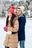 Happy couple ice skating on rink outdoors — Stock Photo