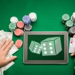 Casino poker player with cards, tablet and chips — Stock Photo #63323895