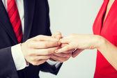 Man putting  wedding ring on woman hand — Stock Photo