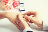 Man putting  wedding ring on woman hand — Stock Photo