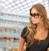 Beautiful young woman in shades — Stock Photo