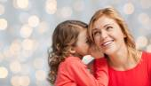 Happy daughter whispering gossip to her mother — Stock Photo