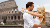 Happy couple hugging over coliseum — Stockfoto