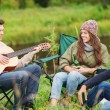 Group of tourists playing guitar in camping — Stock Photo #63508903
