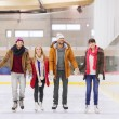 Happy friends on skating rink — Stock Photo #63512961