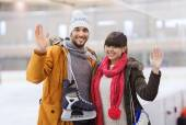 Happy couple with ice-skates on skating rink — Stock Photo