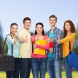 Group of smiling teenagers showing thumbs up — Stock Photo #63594455
