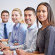 Group of smiling businesspeople meeting in office — Stock Photo #63597079