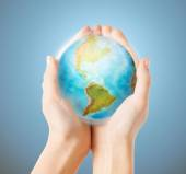 Close up of human hands with earth globe — Stock Photo