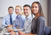 Group of smiling businesspeople meeting in office — Stock Photo