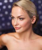 Close up of young woman sitting in bath towel — Stock Photo