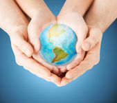 Close up of woman and man hands with earth globe — Stock Photo