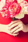 Woman hands with flowers and ring — Stock Photo